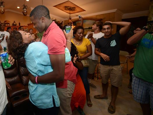 Haitian American Touki Toussaint hugs his mother Kahaso Kiti after being drafted in the first round of the Major League Baseball draft by the Arizona Diamondbacks. 6/5/14. Jim Rassol, Sun Sentinel. (Jim Rassol / Sun Sentinel)