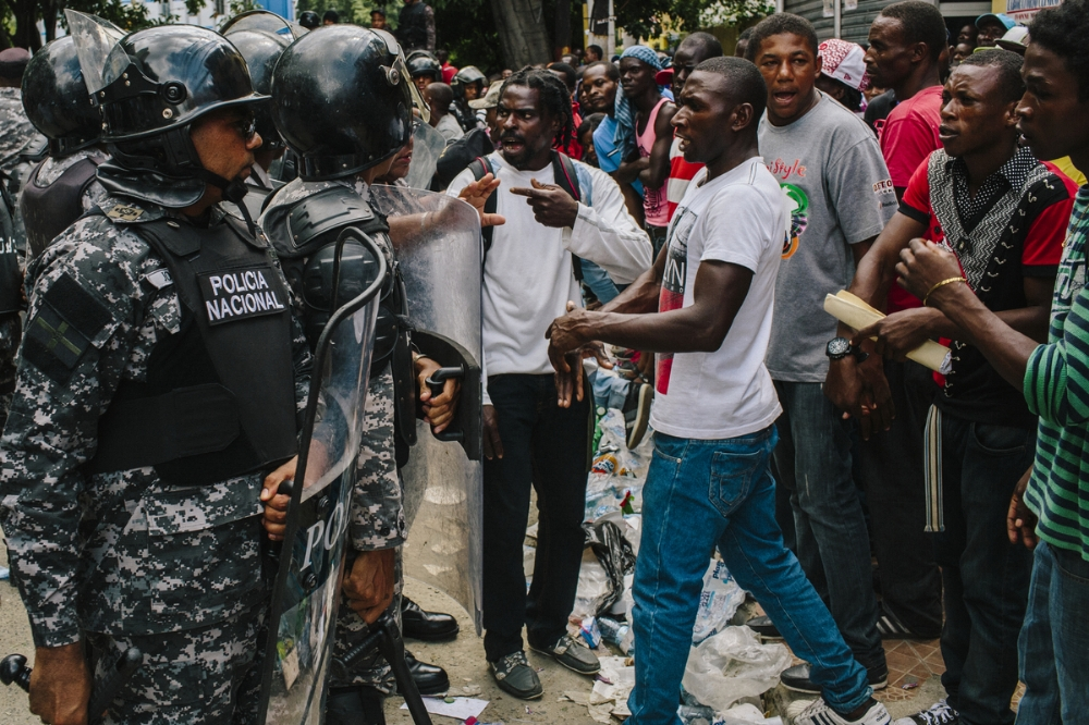 Arguments between police and Haitians like this one, which occurred near the ministry, were commonplace.