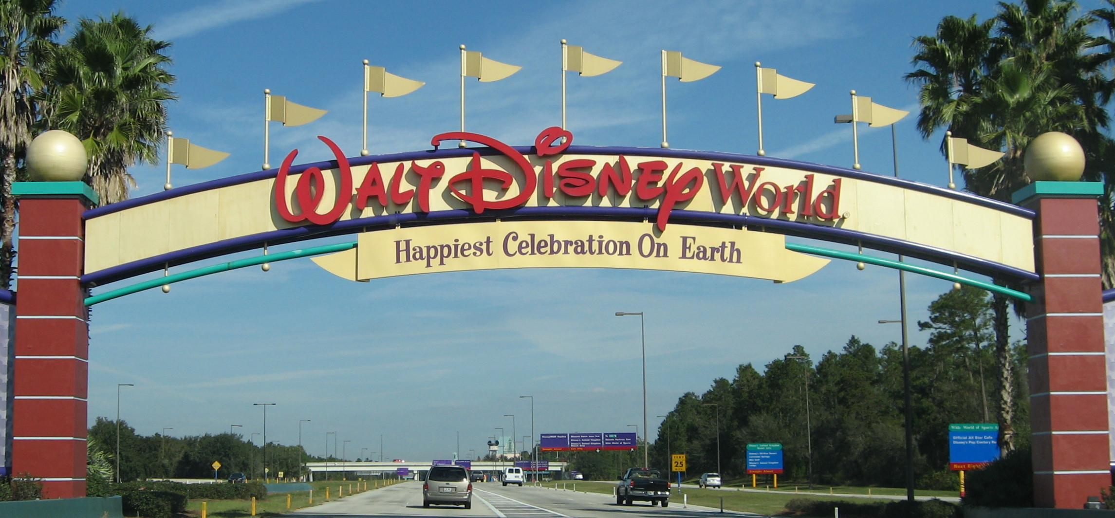 Disney_World_-_Entrance_sign_-_by_inkiboo