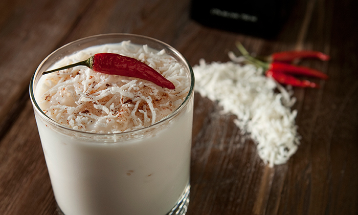 SPICY LS COCO Crushed Thai chili beans 2 oz of LS Cream Liqueur 1 oz of Mango flavored rhum ¼ oz of coconut flavored rhum 1 oz of milk Add all the ingredients into a shaker. Fill with ice and shake vigorously. Pour into an old fashion glass filled with crushed ice. Add grated coconut. Sprinkle some ground chili on top. Add a red Thai chili pepper on top for decoration.