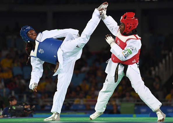 France's Haby Niare (L) competes against Haiti's Aniya Necol Louissaint during their womens taekwondo qualifying bout in the -67kg category as part of the Rio 2016 Olympic Games, on August 19, 2016, at the Carioca Arena 3, in Rio de Janeiro. / AFP / Kirill KUDRYAVTSEV (Photo credit should read KIRILL KUDRYAVTSEV/AFP/Getty Images)